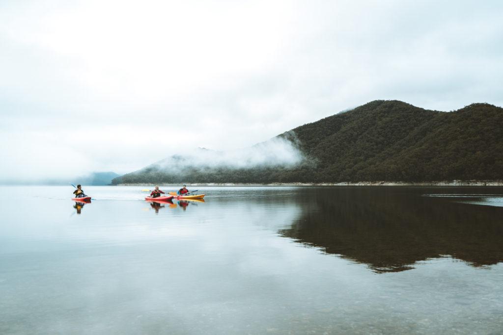 three people kayaking in the Snowy Valleys region