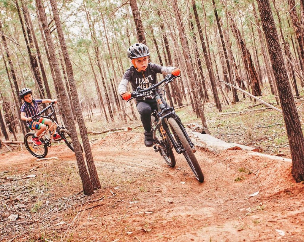 Children mountain biking in the forest in Coolamon