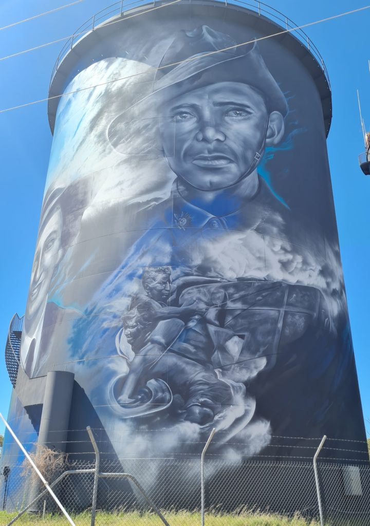 The Image shows a water tower in Hay. On the tower is a painting of Australian soldiers who served during World War II.