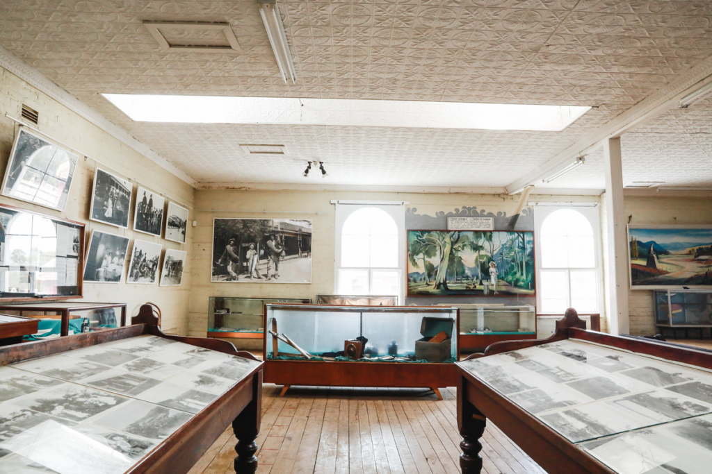 Photographs are on display on walls and tables in a museum in Gundagai.