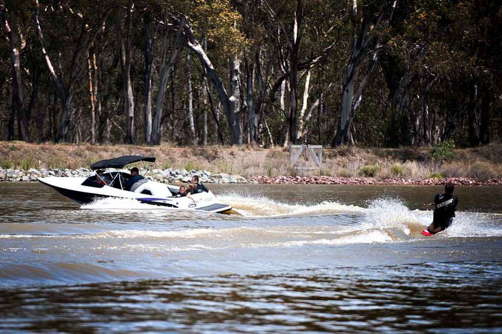 Image shows a boat pulling a water skier on Lake Talbot, Narrandera